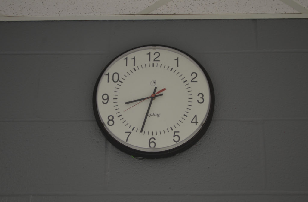 The clock ticks during the mornings early hours (BluePrints Photo/Dustin Braden).