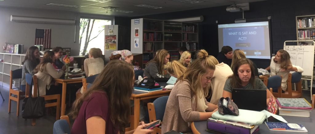 Photo+by+Kylee+McFarland.+Seniors+learning+about+college+in+the+schools+library.+