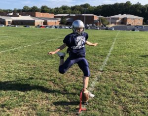 Freshman kicker Ella Dement prepares to kick a field goal in practice. She is the only girl on Granvilles high school football team. (PHOTO COURTESY OF TREVOR CRUMLEY)