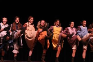 Actresses, such as Anya Mitton-Fry, Esme Chin-Parker, Katie Gold, Gabriela Shcnidt, Sydney Flora, Allison Collins, and Alexa Mitton, dance in Its A Hard knock Life. Photo courtesy to Lexi Robertson