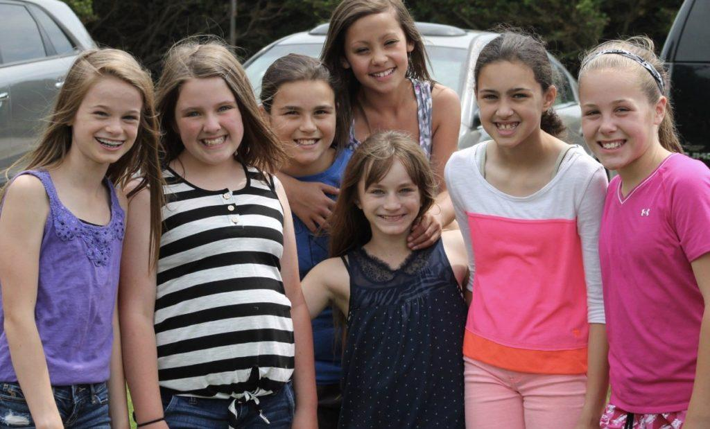 During the 5th Grade Picnic, Julia Patton, McKenna Beitzel, Ella Gravitt, Abigal Burkholder, Lillie Long, Olivia Garland, and Sophie Shaw all pose for a picture.