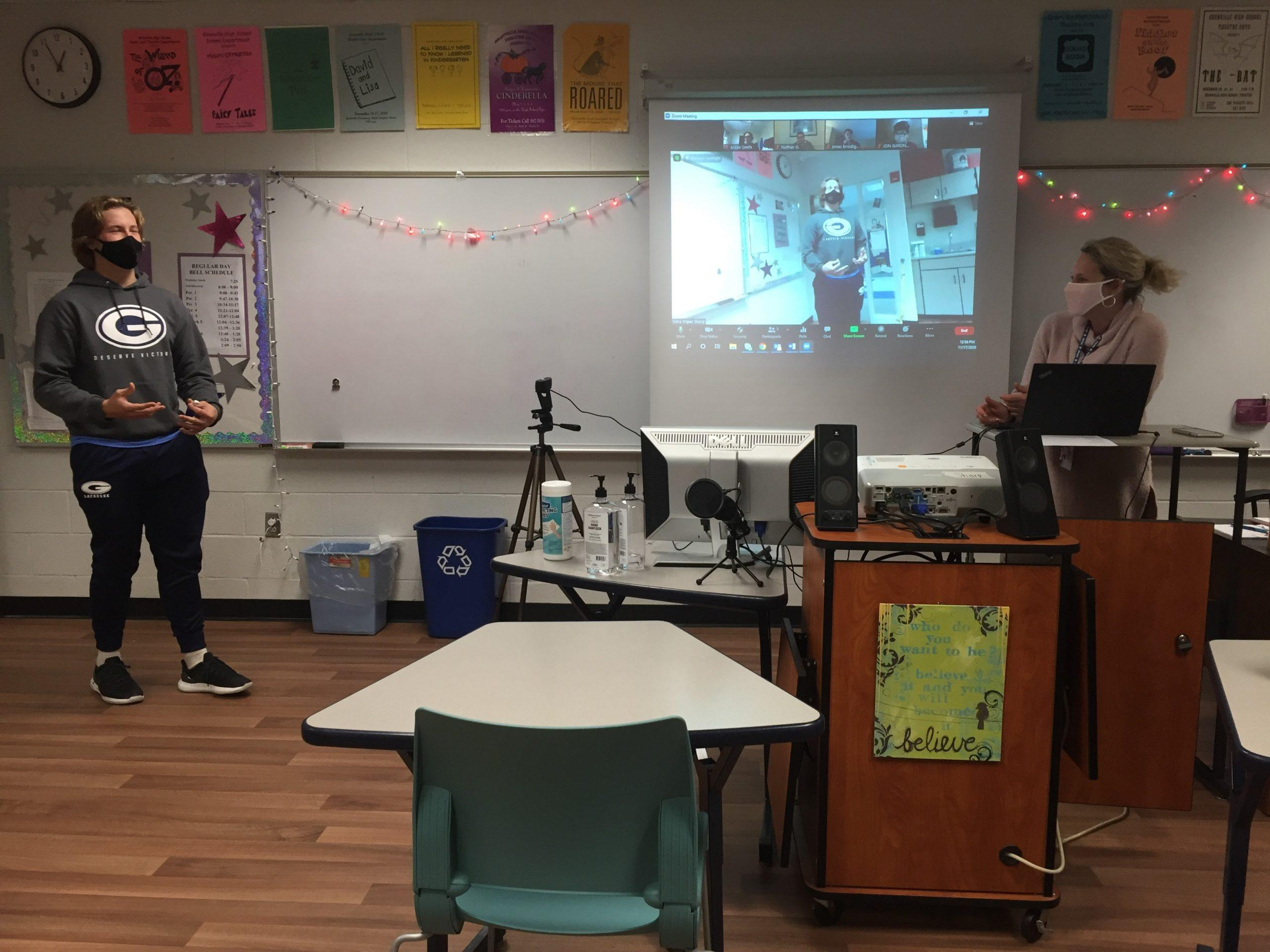 An in-person drama student performs a monologue in front of a camera so remote students can view his performance. Drama teacher Sara Sharp was one of twenty teachers to receive equipment from the grant.
