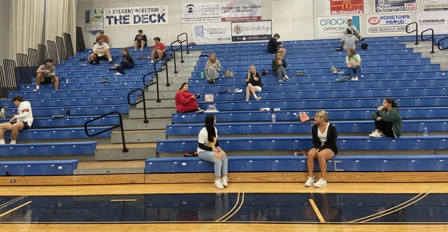 Seniors and Juniors are spaced out in the gym for lunch.