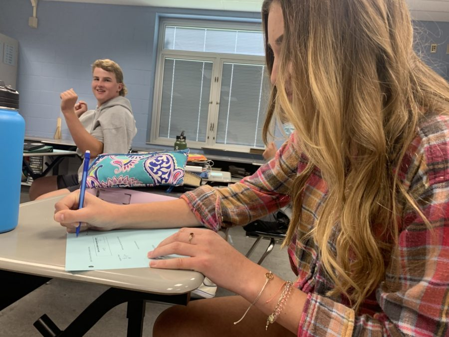 Ava Poling works on homework during class. She enjoys this school year because she can work with a paper and pencil.