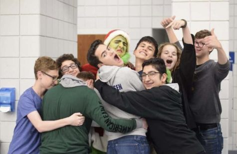 George Turner who played the role of the Grinch celebrates with some of the cast after the play.