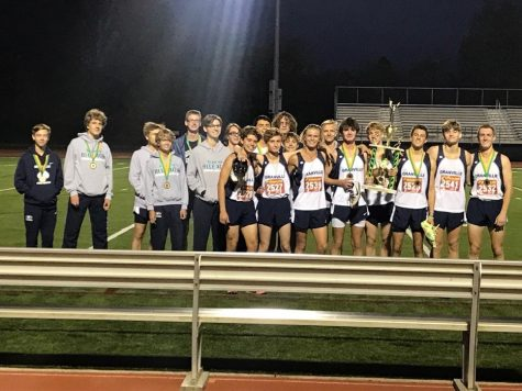 The boys cross country team celebrates their win in the Dublin Jerome Green Open. Photo Source: Acesdistance Twitter