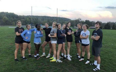 The Junior Powder Puff team practices for the game.